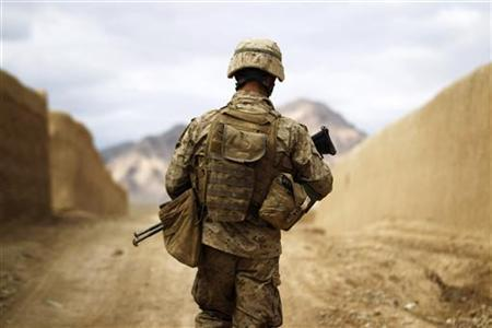 A U.S. Marine from the First Battalion Eighth Marines Alpha Company patrols through the town of Nabuk in southern Afghanistan's Helmand province, February 18, 2011. REUTERS/Finbarr O'Reilly