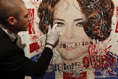 Opera Gallery Director Jean-David Malat poses with ''God Save the Future Queen'', a mixed media artwork by Zoobs and reminiscent of the cover of the 1977 Sex Pistols album in London, February 4, 2011. REUTERS/Suzanne Plunkett