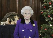 <p>Britain's Queen Elizabeth records her Christmas Day broadcast to the Commonwealth in the Chapel Royal at Hampton Court Palace, west of London, December 15, 2010, in this photograph released December 23, 2010. REUTERS/John Stillwell/Pool</p>