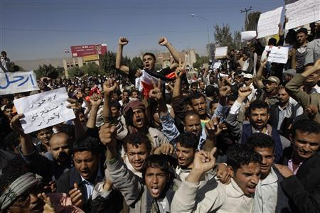 Anti-government protesters shout at government backers during a protest in Sanaa February 20, 2011. REUTERS/Ammar Awad