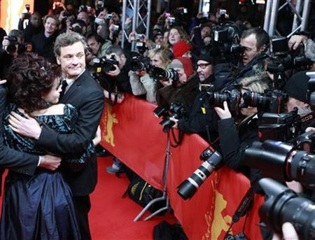 Actors Helena Bonham Carter (L) and Colin Firth arrive at the red carpet for the screening of the movie 'The King's Speech' at the 61st Berlinale Film Festival in Berlin February 16, 2011. REUTERS/Thomas Peter