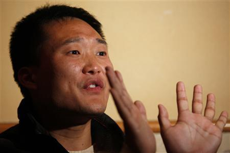 Jia Jingchuan, a 27-year-old production technician for Wintek, shows his palms in a cafe in Suzhou, Jiangsu province February 18, 2011. Jia is one of the Chinese workers at a factory making touch screens on contract for Apple who have urged the U.S. company to help address their grievances over a chemical poisoning they said could still harm their health. Wintek, the Taiwanese company that owns the factory in east China's Suzhou industrial park, has said it used hexyl hydride, also called n-hexane, from May 2008 to August 2009, but stopped after discovering it was making workers ill. Workers showed Reuters a Chinese-language copy of the letter, signed by five workers claiming to represent employees, meant for Apple CEO Steve Jobs. An English version had been sent to Apple. The poisonings were mentioned in a recent report from Apple, which sources many of its strong-selling iPhones, iPads and other devices to contract manufacturers in China. That report said 137 workers had been hospitalised because of poisoning but had all recovered, a conclusion also offered by Wintek. Apple declined to comment on the workers' letter and referred a reporter back to its supplier report. Picture taken February 18, 2011. REUTERS/Aly Song