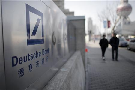 A Deutsche Bank sign is seen outside of a corporate building in Shanghai's financial district February 23, 2011. Western investment banks are keen to underwrite more IPOs on China's Shenzhen exchange this year as a surging economy turns the once insignificant market into a fundraising hotbed. The moves by UBS, Deutsche Bank and others into Shenzhen will raise competition for little-known local players such as Ping An Securities and Huatai Securities, who have underwritten IPOs worth billions of dollars, and driven down high fees. Picture taken February 23, 2011. REUTERS/Carlos Barria