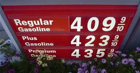 Gas prices are seen posted at a petrol station in Los Angeles, February 22, 2011. REUTERS/Gary Hershorn