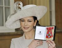 <p>Welsh actress Catherine Zeta-Jones poses for photographers with her Commander of the Order of the British Empire (CBE), after it was awarded to her by Britain's Prince Charles during an Investiture Ceremony at Buckingham Palace, in London February 24, 2011. REUTERS/John Stillwell/Pool</p>
