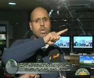 <p>Saif al-Islam, son of Libyan leader Muammar Gaddafi, gestures as he speaks during an interview on state television, in this still image taken from video broadcast February 24, 2011. World leaders condemned Muammar Gaddafi's bloody crackdown on a revolt that has split Libya, but took little action to halt the bloodshed from the latest upheaval reshaping the Arab world. REUTERS/Libya TV via Reuters TV</p>