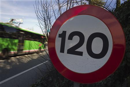 A car drives past a speed control sign on highway A-6 at Madrid February 25, 2011. REUTERS/Susana Vera
