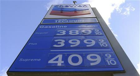 Gasoline prices are seen posted at a petrol station in Hollywood, California, February 26, 2011. REUTERS/Gary Hershorn