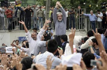 Defeated presidential candidate Mirhossein Mousavi attends a rally in support of him in Tehran June 15, 2009. REUTERS/Jamejam Online