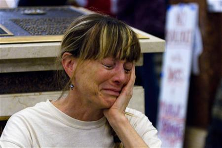 Michaela Torcaso of Madison, Wisconsin is overcome with emotion as demonstrators continue to occupy the state Capitol in protest against proposed budget cuts in Madison, February 27, 2011. REUTERS/Darren Hauck