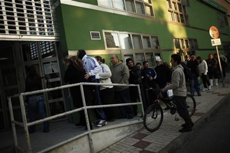 People wait in line to enter a government job centre in Malaga, southern Spain February 2, 2011. REUTERS/Jon Nazca