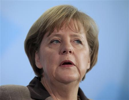 German Chancellor Angela Merkel makes a statement during a news conference in Berlin March 2, 2011. REUTERS/Thomas Peter