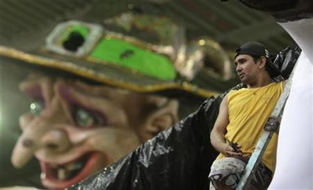 A worker stands next to a carnival float at Grande-Rio Samba School in Rio de Janeiro March 1, 2011. The Rio de Janeiros's Carnival parade will held March 5-6. REUTERS/Ricardo Moraes