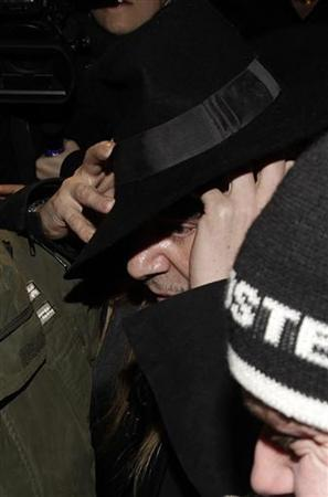 Fashion designer John Galliano leaves after a hearing in a police station in Paris February 28, 2011. REUTERS/Jacky Naegelen