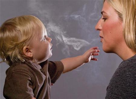This handout image, released on November 10, 2010 depicts a mother blowing cigarette smoke in a child's face in one of the Federal Drug Administration's proposed new ''graphic health warnings.'' REUTERS/HHS/Handout