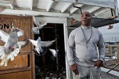 "<p>Former boxer Mike Tyson stands beside birds on the set of his six-part documentary ""Taking on Tyson"", in this undated publicity photograph. Tyson says pigeons were his first love as a bullied kid on the tough streets of Brooklyn, and later on, birds gave him peace and tranquillity before and after some of his most bruising professional fights. Now, the man nicknamed ""Iron Mike"" for his ferocious boxing style is sharing that passion and showing a gentler side of himself in ""Taking on Tyson"", starting on the Animal Planet cable TV channel on Sunday, March 6, 2011. REUTERS/Mat Szwajkos for Animal Planet/2010 Discovery Communications/Handout</p>"