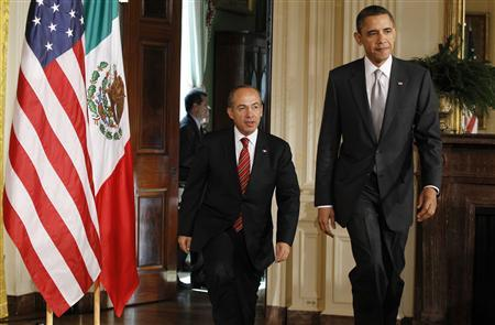 President Obama and Mexican President Felipe Calderon arrive for a news conference in the East Room of the White House, March 3, 2011. REUTERS/Jason Reed