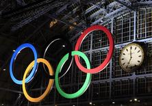 <p>The Olympic Rings, the symbol of the Olympic Games, are illuminated at St Pancras international station in London March 3, 2011. REUTERS/Eddie Keogh</p>