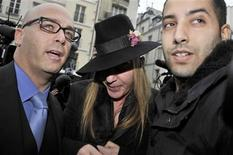 <p>Fashion designer John Galliano and his lawyer Stephane Zerbib (L) arrive for a hearing at a police station in Paris, February 28, 2011. REUTERS/Gonzalo Fuentes</p>