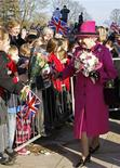 <p>Britain's Queen Elizabeth speaks to school children after her visit to the Royal Shakespeare Theatre in Stratford-upon-Avon, central England March 4, 2011. REUTERS/Darren Staples</p>