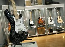 "<p>A 2007 Fender Stratocaster ""Crossroads"" guitar (L) autographed by 24 guest musicians who appeared at Eric Clapton's Crossroads Festival in June 2010, is displayed at the Bonhams auction house in New York March 4, 2011. REUTERS/Brendan McDermid</p>"