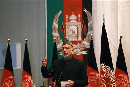 Afghanistan's President Hamid Karzai gives a speech during an event to mark International Women's Day in Kabul March 8, 2011. REUTERS/Omar Sobhani