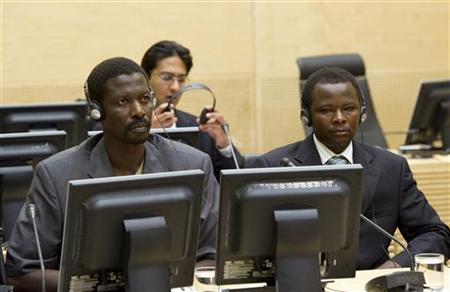 Abdallah Banda Abakaer Nourain (L) and Saleh Mohammed Jerbo Jamus, both suspected of having committed war crimes in Darfur, arrive voluntarily at the International Criminal Court in The Hague, Netherlands, June 17, 2010. REUTERS/Toussaint Kluiters/United Photos