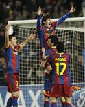 <p>Messi comemora terceiro gol contra Arsenal na vitória do Barcelona pela Liga dos Campeões.08/03/2011.REUTERS/Albert Gea</p>