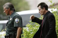 <p>Actor Charlie Sheen (R) leaves the Pitkin County Courthouse after a sentencing hearing in Aspen, Colorado August 2, 2010. REUTERS/Rick Wilking</p>