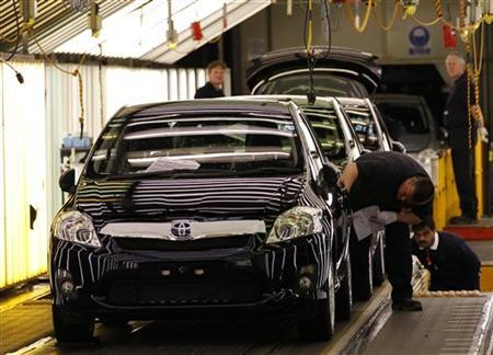Cars are inspected at the end of the production line at the Toyota factory in Derby, central England, March 7, 2011. REUTERS/Darren Staples