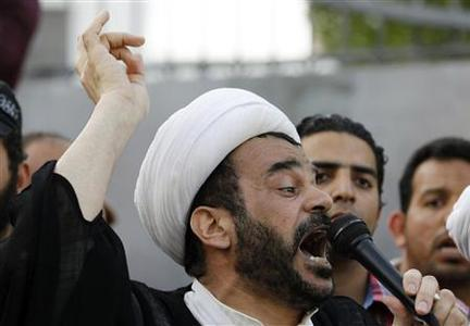 Sheikh Mohammed Habib Muqdad shouts anti-government slogans while talking to protesters in front of the Bahrain Immigration Directorate in Manama March 9, 2011. REUTERS/Hamad I Mohammed
