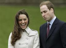 <p>Britain's Prince William and his Fiancee, Kate Middleton, smile during a visit to the Greenmount Agriculture & Food College, in Antrim, Northern Ireland March 8, 2011. REUTERS/Phil Noble</p>