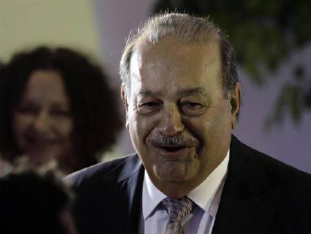 Mexican tycoon Carlos Slim arrives to attend the opening of the Soumaya museum in Mexico City March 1, 2011. REUTERS/Henry Romero