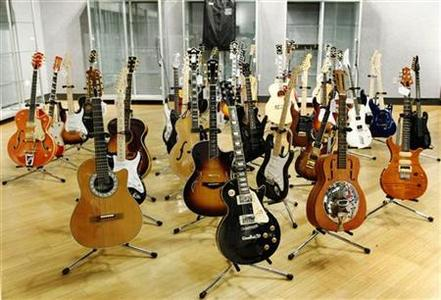 Guitars belonging to British music icon Eric Clapton are displayed at the Bonhams auction house in New York March 4, 2011. More than 70 guitars belonging to Clapton will go on the auction block in New York next week to raise money for his drug and alcohol treatment center in the Caribbean. REUTERS/Brendan McDermid