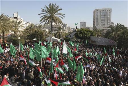 Palestinians wave Hamas flags during a rally in Gaza city, calling for an end to Palestinian divisions, March 4, 2011. REUTERS/Mohammed Salem