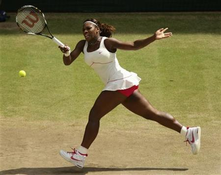Serena Williams of the U.S. hits a return to Vera Zvonareva of Russia during the womens' singles final at the 2010 Wimbledon tennis championships in London, July 3, 2010. REUTERS/Dave Thompson/Pool