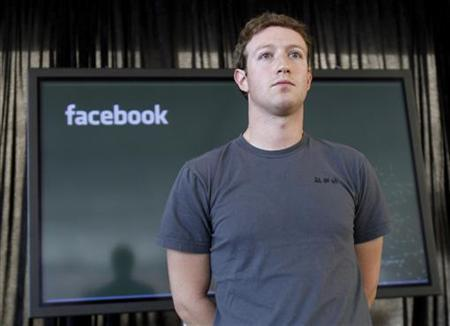 Facebook CEO Mark Zuckerberg listens to a question from the audience during a news conference in San Francisco, November 15, 2010. REUTERS/Robert Galbraith