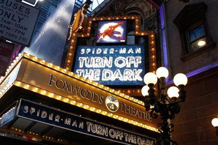 Banners advertising the Broadway play ''Spiderman: Turn Off The Dark'' shine in front of the Foxwoods Theater in New York December 23, 2010. REUTERS/Lucas Jackson