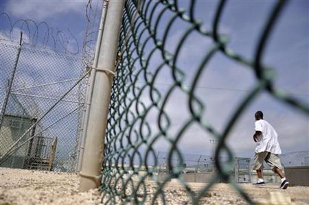 In this photo, reviewed by a U.S. Department of Defense official, a Guantanamo detainee runs inside an exercise area at the detention facility at Guantanamo Bay U.S. Naval Base April 27, 2010. REUTERS/Michelle Shephard/Pool