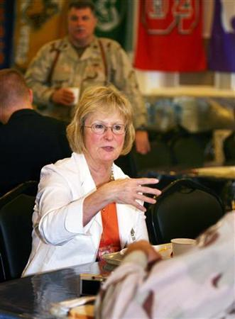 Representative Judy Biggert from Illinois has breakfast with U.S. troops during a visit to the U.S. embassy in Baghdad June 25, 2006. REUTERS/Khalid Mohammed/Pool