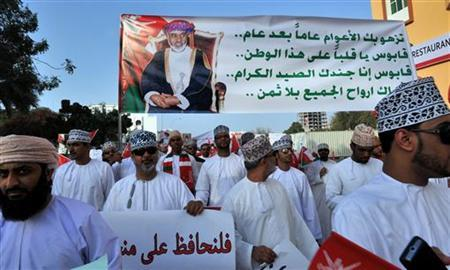 Demonstrators carry banners during a march against the unrest which took place in neighboring city Sohar and expressing support for ruler Sultan Qaboos bin Said, in Muscat March 1, 2011. The banner reads, ''Year after year you flourish... Qaboos you are the heart of this nation... Qaboos we are your loyal and true soldiers... We sacrifice our souls to you loyally and unconditionally.'' REUTERS/Sultan Al Hasani