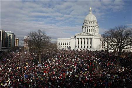 Crowds gather to see the 14 democratic senators that left the state to protest the bill proposed by the Gov. Scott Walker as crowds continue to protest at the Wisconsin State Capitol in Madison, Wisconsin March 12, 2011. REUTERS/Darren Hauck