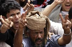 <p>Anti-government protesters shout slogans during a rally outside Sanaa University March 13, 2011. REUTERS/Khaled Abdullah</p>