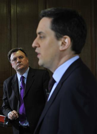 The leader of the Labour Party, Ed Miliband (R), addresses a news conference as Shadow Chancellor Ed Balls, listens, in London March 14, 2011. REUTERS/Toby Melville