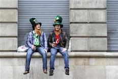 <p>Revellers sit on a wall during the annual St Patrick's Day Parade and Festival, in central London, March 13, 2011. REUTERS/Paul Hackett</p>