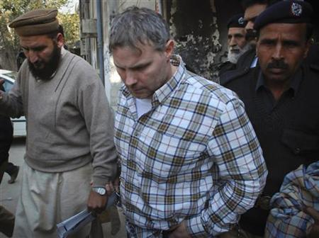 U.S. consulate employee Raymond Davis is escorted by police and officials out of court after facing a judge in Lahore, January 28, 2011. REUTERS/Tariq Saeed