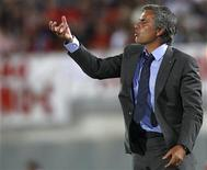 <p>Real Madrid coach Jose Mourinho gestures during their Spanish first division match against Real Mallorca at the Iberostar stadium in Palma de Mallorca, August 29, 2010. REUTERS/Albert Gea</p>
