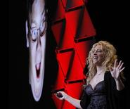"<p>Jane McGonigal, author of the book ""Reality is Broken: Why Games Make Us Better and How They Can Change the World"", delivers the keynote address at the PAX East gaming conference in Boston, Massachusetts March 11, 2011. REUTERS/Brian Snyder</p>"