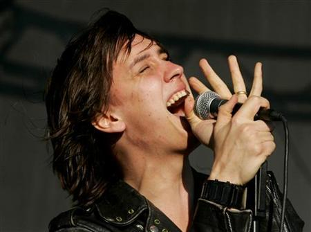Julian Casablancas from ''The Strokes'' performs on the main stage at the 'T in the Park' music festival in Balado, Scotland July 9, 2006. REUTERS/David Moir