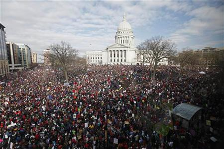 Massive crowds gather to see the 14 democratic senators that left the state to protest the bill proposed by the Gov. Scott Walker as crowds continued to protest at the Wisconsin State Capitol in Madison, March 12, 2011. REUTERS/Darren Hauck